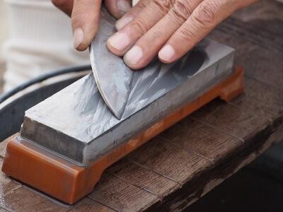 using sharpening stone
