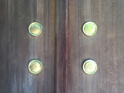 zoom up of brass decoration tacks on doors