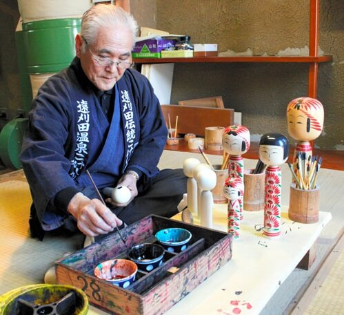 Japanese Traditional Wood Carving Dolls, Kokeshi, craftsman making kokeshi painting