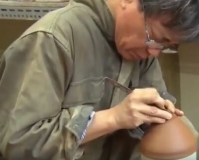 A potter challenging to replicate Yohen Tenmoku tea bowls