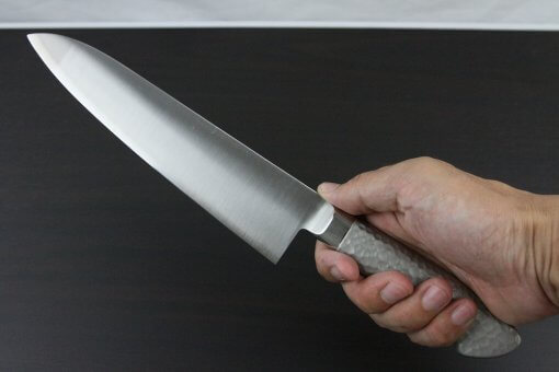 Japanese Chef Knife, Elegance Monaka Series, Gyuto chef knife 210mm, grabbed by a man's hand