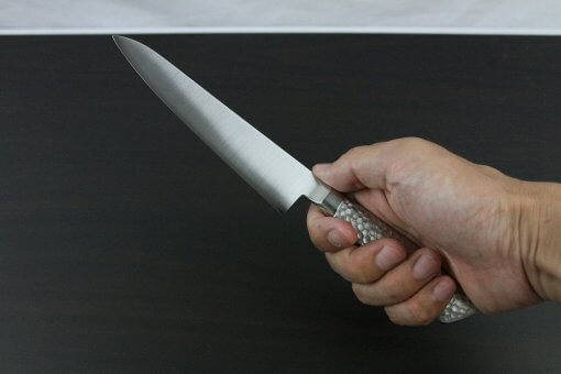Japanese Chef Knife, Elegance Monaka Series, petit knife 150mm, grabbed by a man's hand