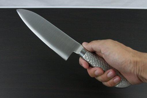 Japanese Chef Knife, Elegance Monaka Series, Santoku multi-purpose knife 165mm, grabbed by a man's hand
