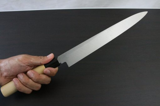 Japanese professional chef knife, left-handed Yanagiba Sushi knife, 1st grade 270mm, grabbed by a man's hand