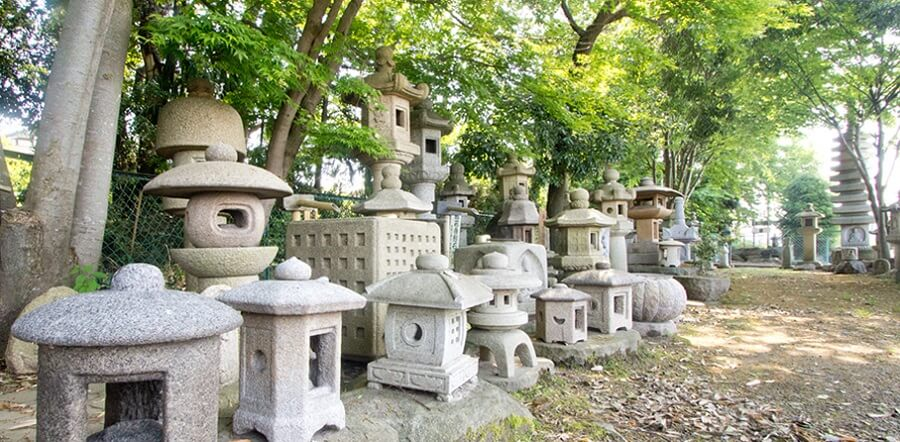Traditional Makabe Stone Lanterns of Japan, bunch of lanterns in a forest