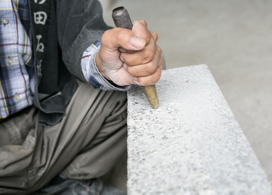 Traditional Makabe Stone Lanterns of Japan, craftsman is making by hand
