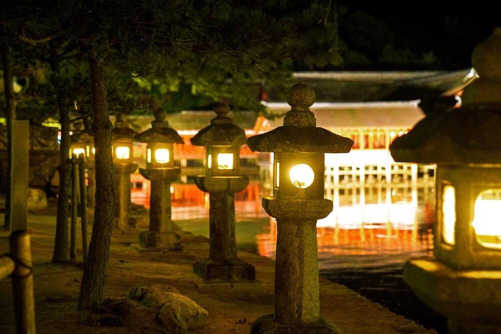 Traditional Makabe Stone Lanterns of Japan, lighted lanterns at night