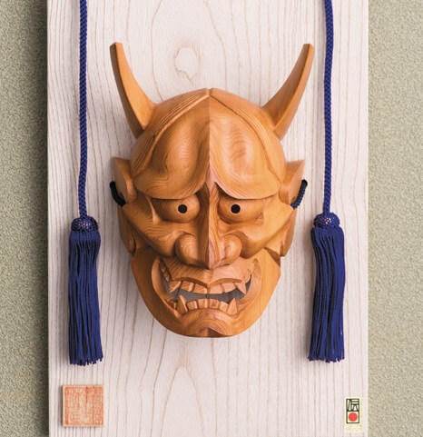 Hida Ichii one-knife carving, a Japanese traditional craft, face object of Oni daemon