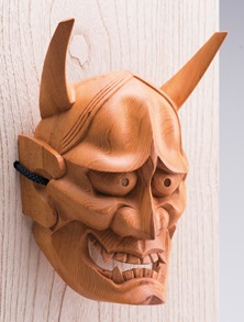 Hida Ichii one-knife carving, a Japanese traditional craft, diagonal front view of oni mask