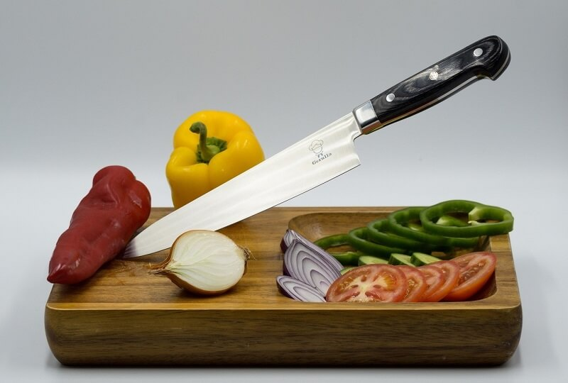 Japanese Chef's Knives (Gyuto) and Kitchen Knives (Santoku), knife on cutting board with vegetables