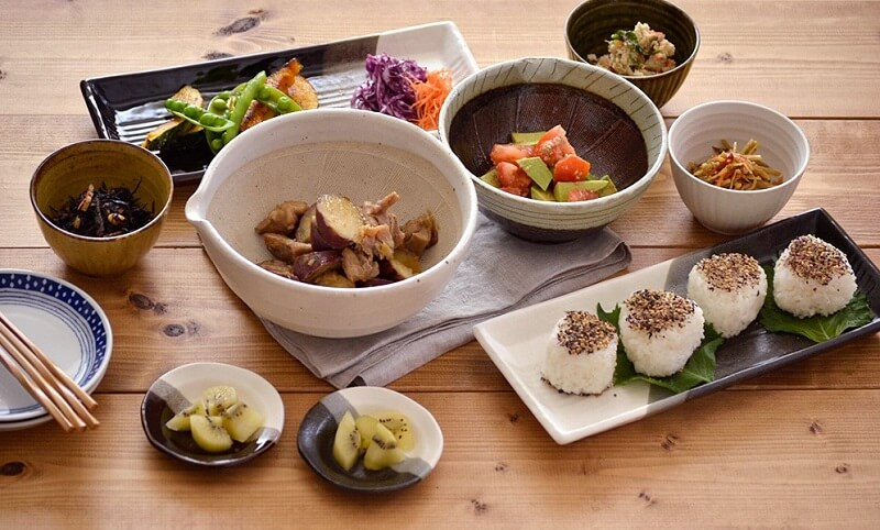 foods are served in a japanese style dishes and bowls