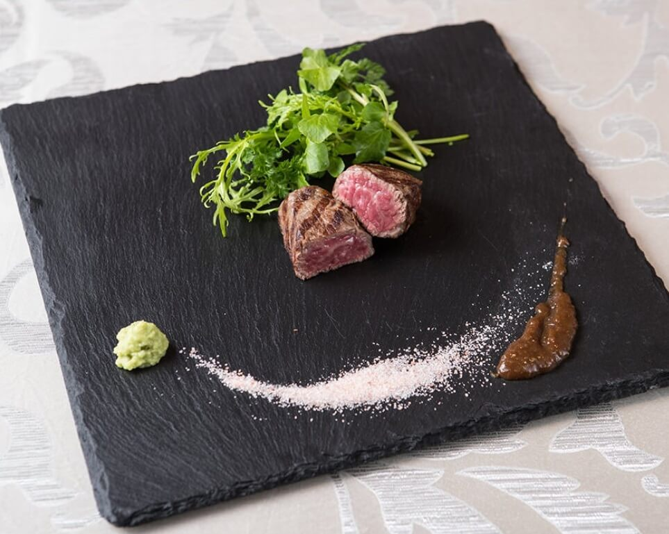 Wagyu Japanese beef, an excellent Japanese cuisine, serving steak on a beautiful black plate