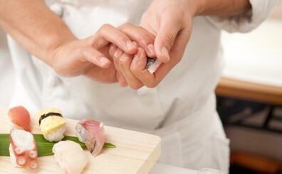 a Sushi chef is making Sushi Nigiri