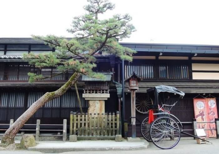 Hida Shunkei Lacquerware, a Japanese traditional craft, rikshaw in front of an old housing