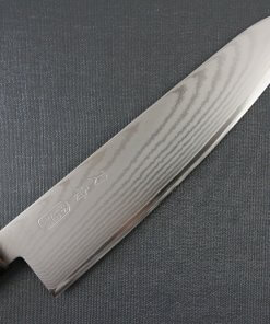 Toshu Santoku multi-purpose Japanese chef's knife, octagonal wood handle, details of damascus blade front side