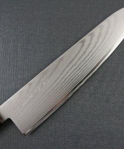 Toshu Santoku multi-purpose Japanese chef's knife, octagonal wood handle, details of damascus blade front side
