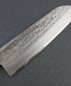 Toshu Santoku multi-purpose Japanese chef's knife, hammered finish blade and mahogany handle, details of blade front side