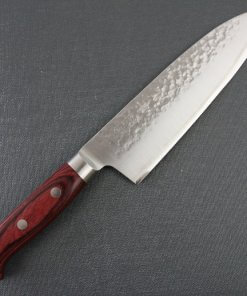 Toshu Santoku multi-purpose Japanese chef's knife, hammered finish blade and red handle, entire front view