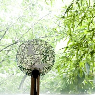 Kyoto Uchiwa Fans, a Japanese craft, high grade product example, placed in a beautiful room