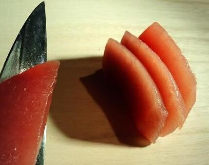 cut tuna sashimi by a Japanese sushi knife