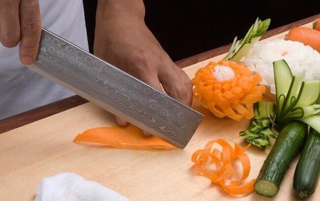 Nakiri Japanese vegetable knife, decoration cutting by a professional chef