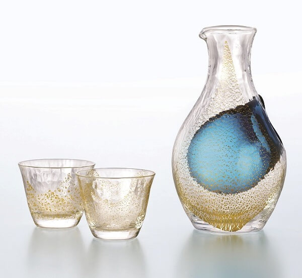 Sake in a glass bottle and Sake cups