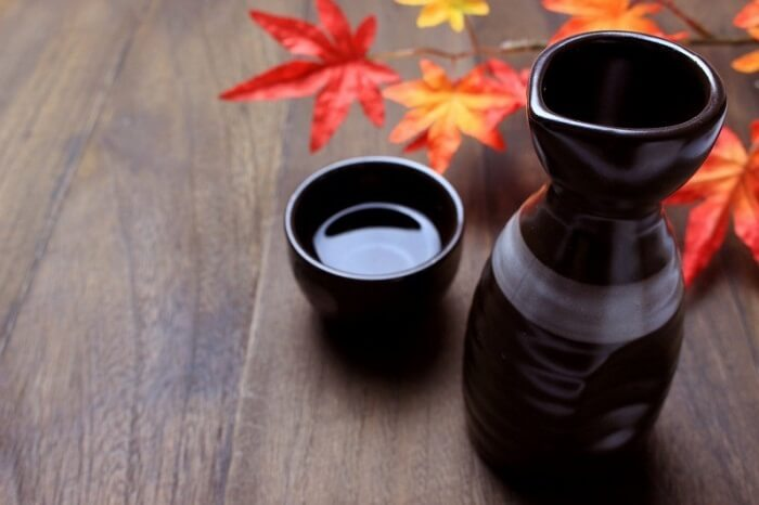 Japanese Sake in a cup and bottle