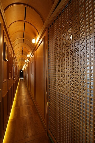 Seven Stars in Kyushu, cruise train of Japan, corridor decorated with Ohkawa woodworks