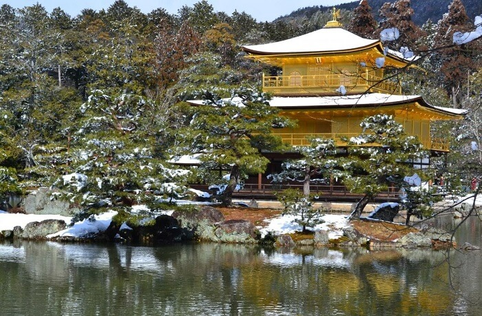 Kinkakuji temple in winter, snow cap on its roof