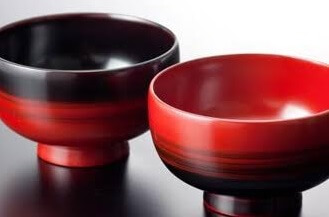 red and black Japanese lacquerware soup cups