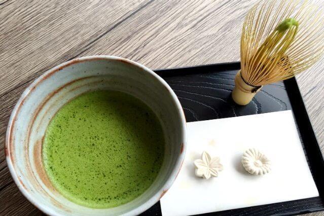 Japanese Tea ceremony, tea and sweet set on a tray