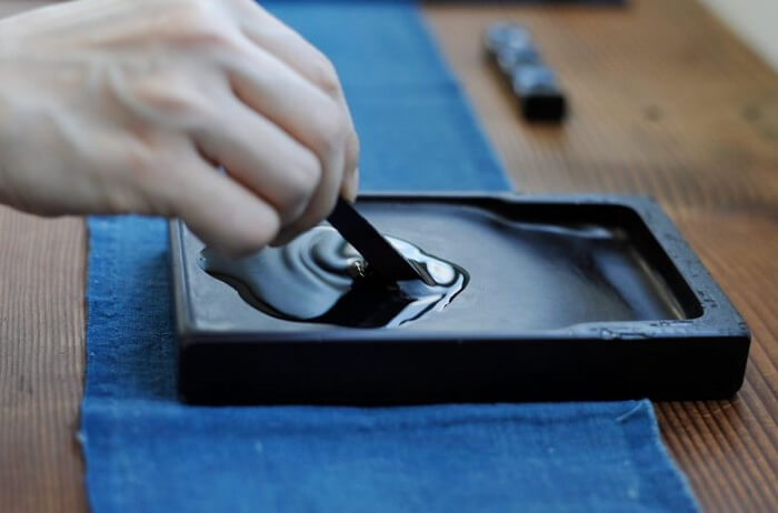 dissolving sumi ink on suzuri for Shodo calligraphy writing